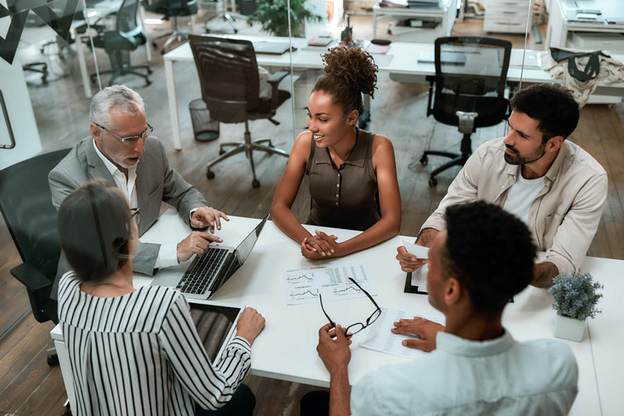 Get Insurance Quote - Group of Co Workers Sitting Around a Conference Table